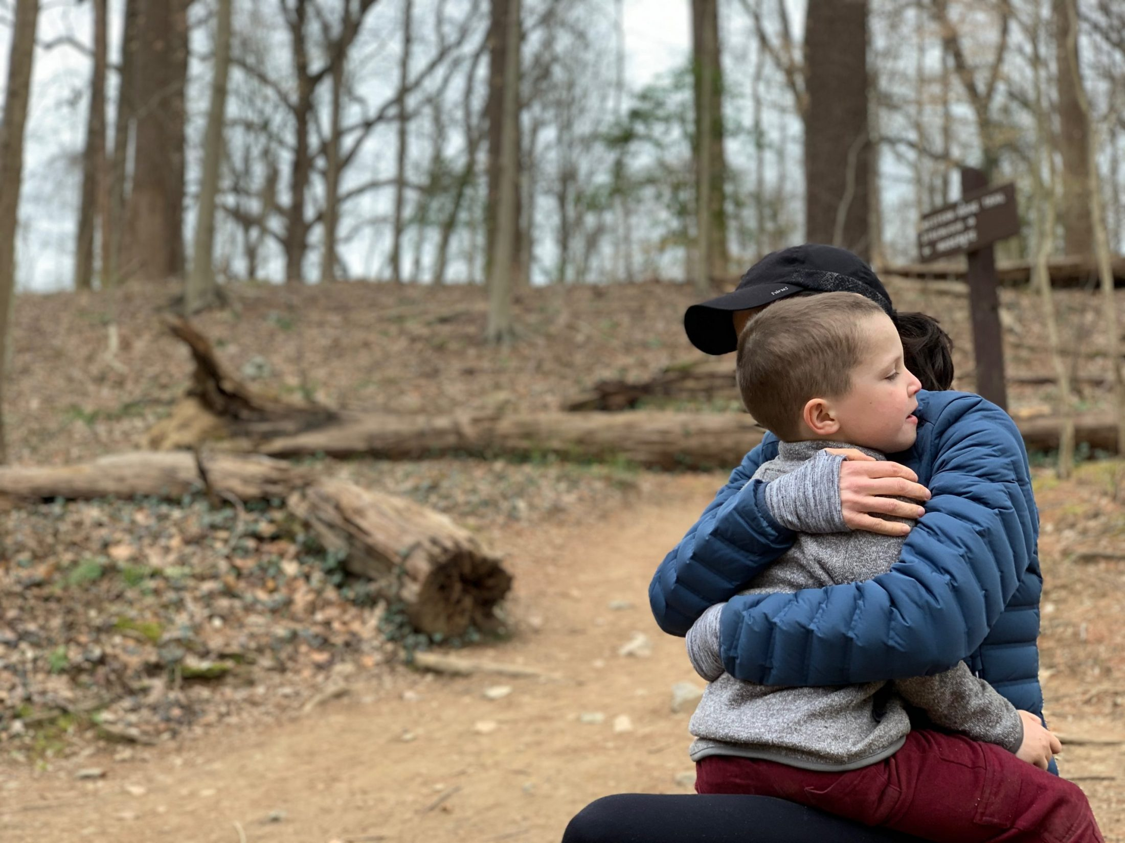 DC widow blog writer Marjorie Brimley hugs her son Tommy in the woods