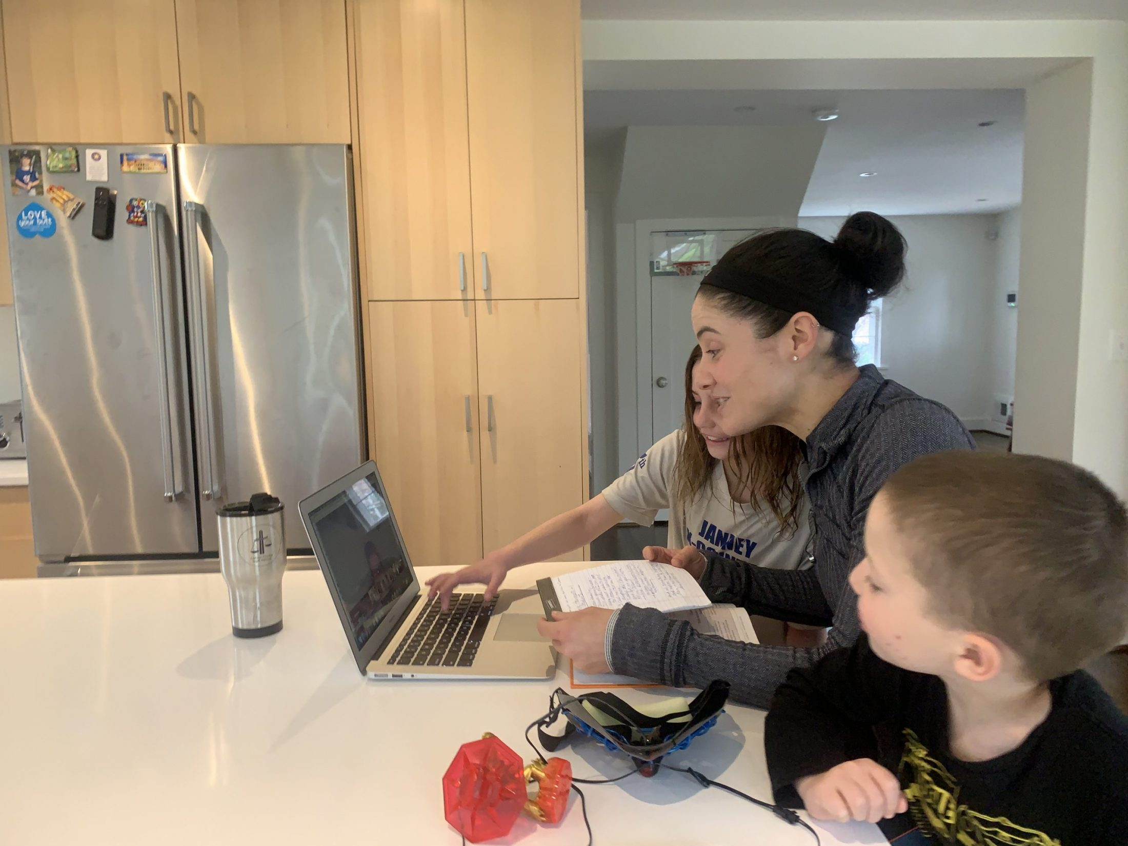 DC widow blog writer Marjorie Brimley teaches students remotely surrounded by her kids