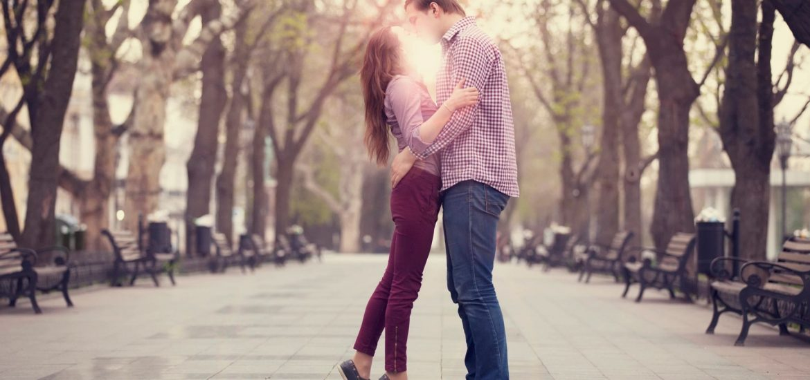 Stock image of couple kissing in park for DC widow blog by Marjorie Brimley