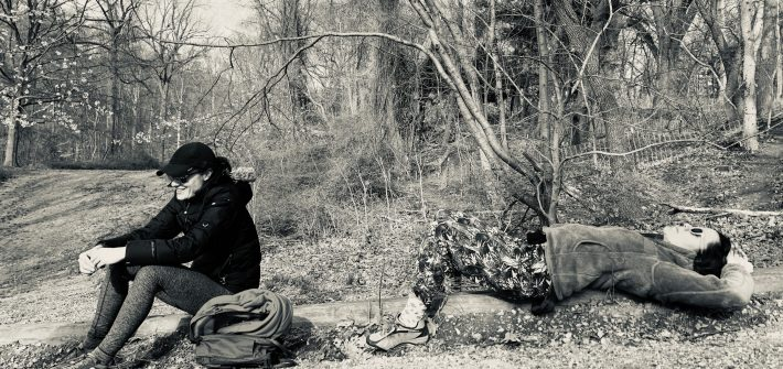DC widow blog writer Marjorie Brimley in sits in woods with friend