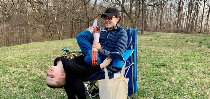 DC widow blog writer Marjorie Brimley plays with son while sitting in a chair at park