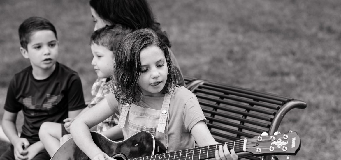 Claire, daughter of DC widow blog writer Marjorie Brimley, plays guitar