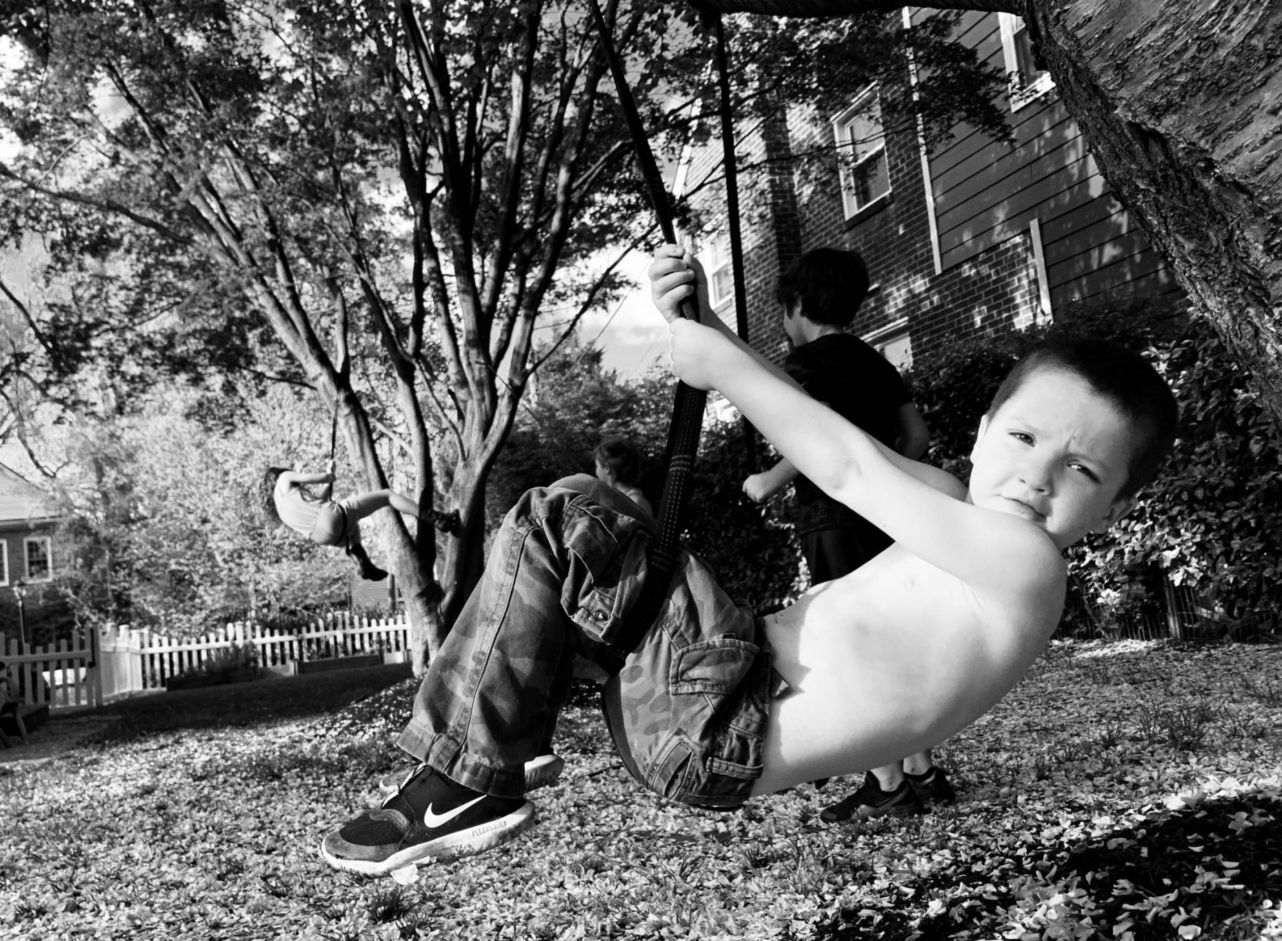 Son of DC widow blog writer Marjorie Brimley holding on to rope swing in backyard