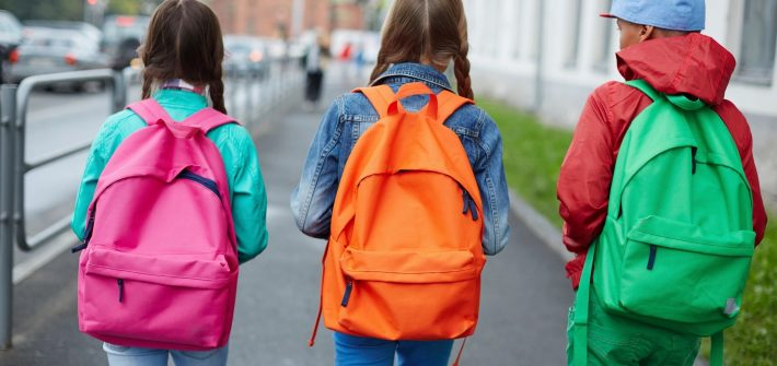 Kids walking into school with backpacks like children of DC widow blog writer Marjorie Brimley