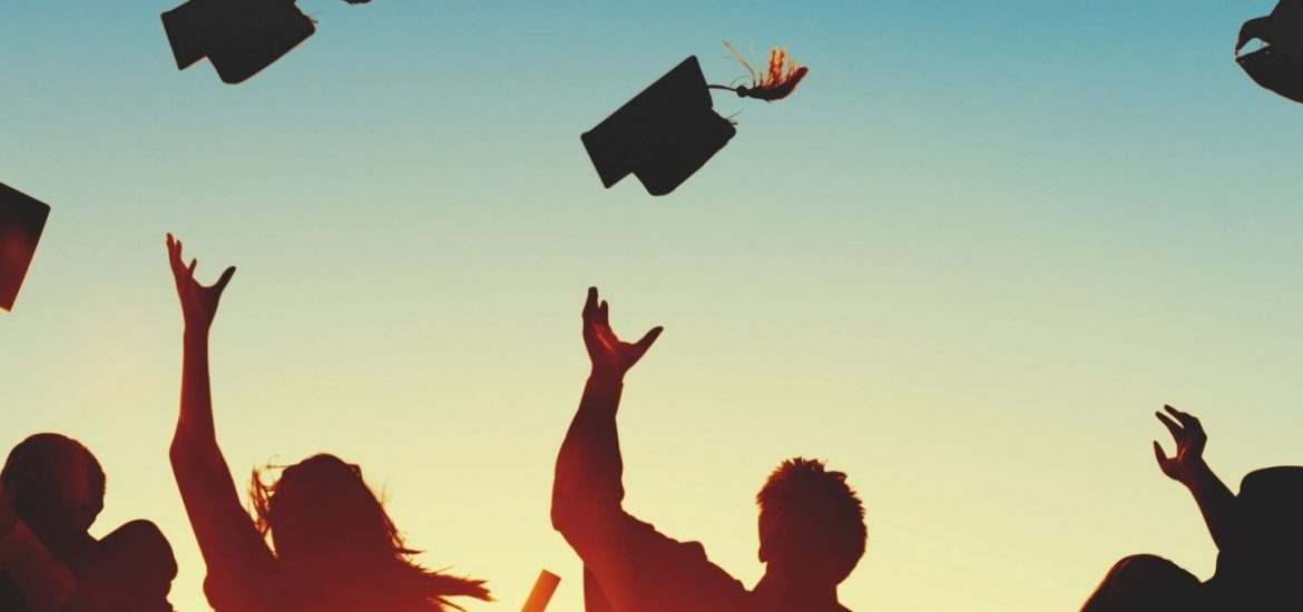Students throw caps in air during graduation like that during speech by DC widow blog writer Marjorie Brimley