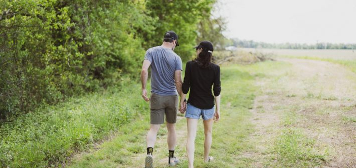 DC widow blog writer Marjorie Brimley walks holding hands with partner in field