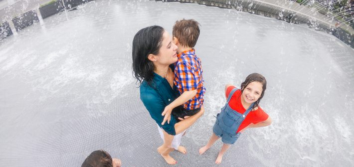 DC widow blog writer Marjorie Brimley plays with her children in a fountain