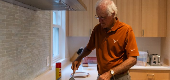 Father of DC widow blog writer Marjorie Brimley cooks egg in kitchen
