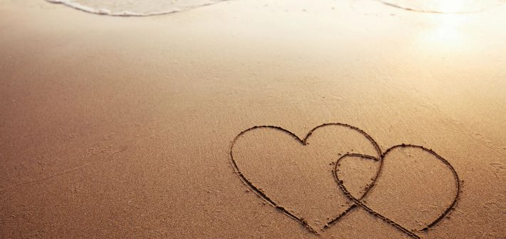 Beach with hearts for blog by DC widow writer Marjorie Brimley