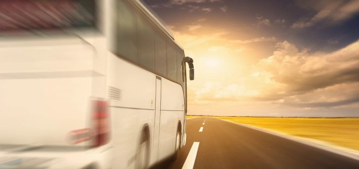 Bus at sunset for blog by DC widow writer Marjorie Brimley