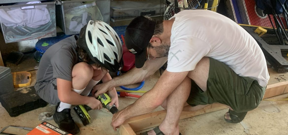 Boyfriend and son of DC widow blog writer Marjorie Brimley work with tools in garage