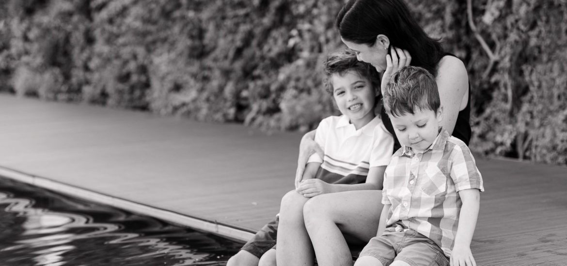 Black and white image of DC widow blog writer Marjorie Brimley and her boys