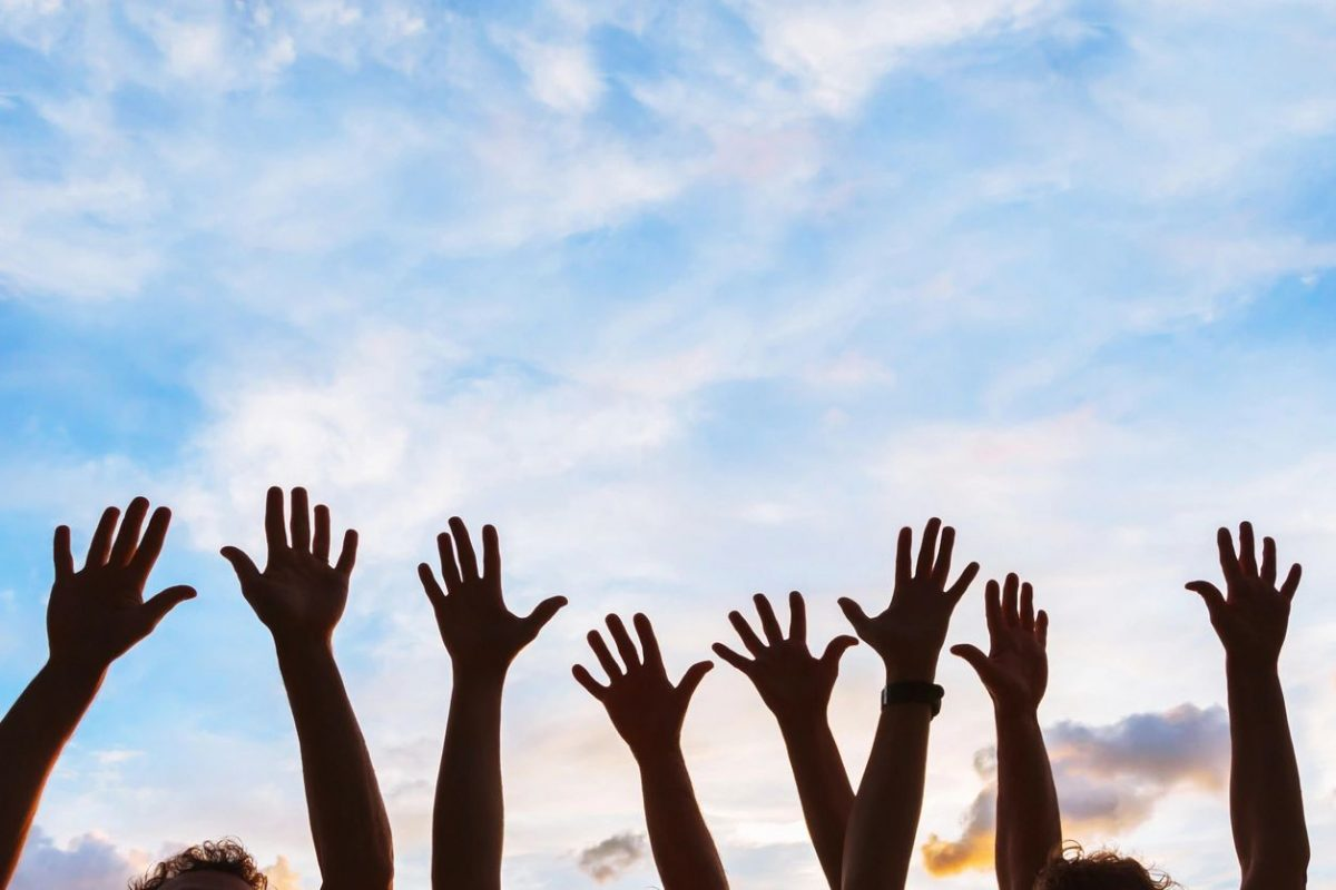 Hands in air for blog by DC widow writer Marjorie Brimley