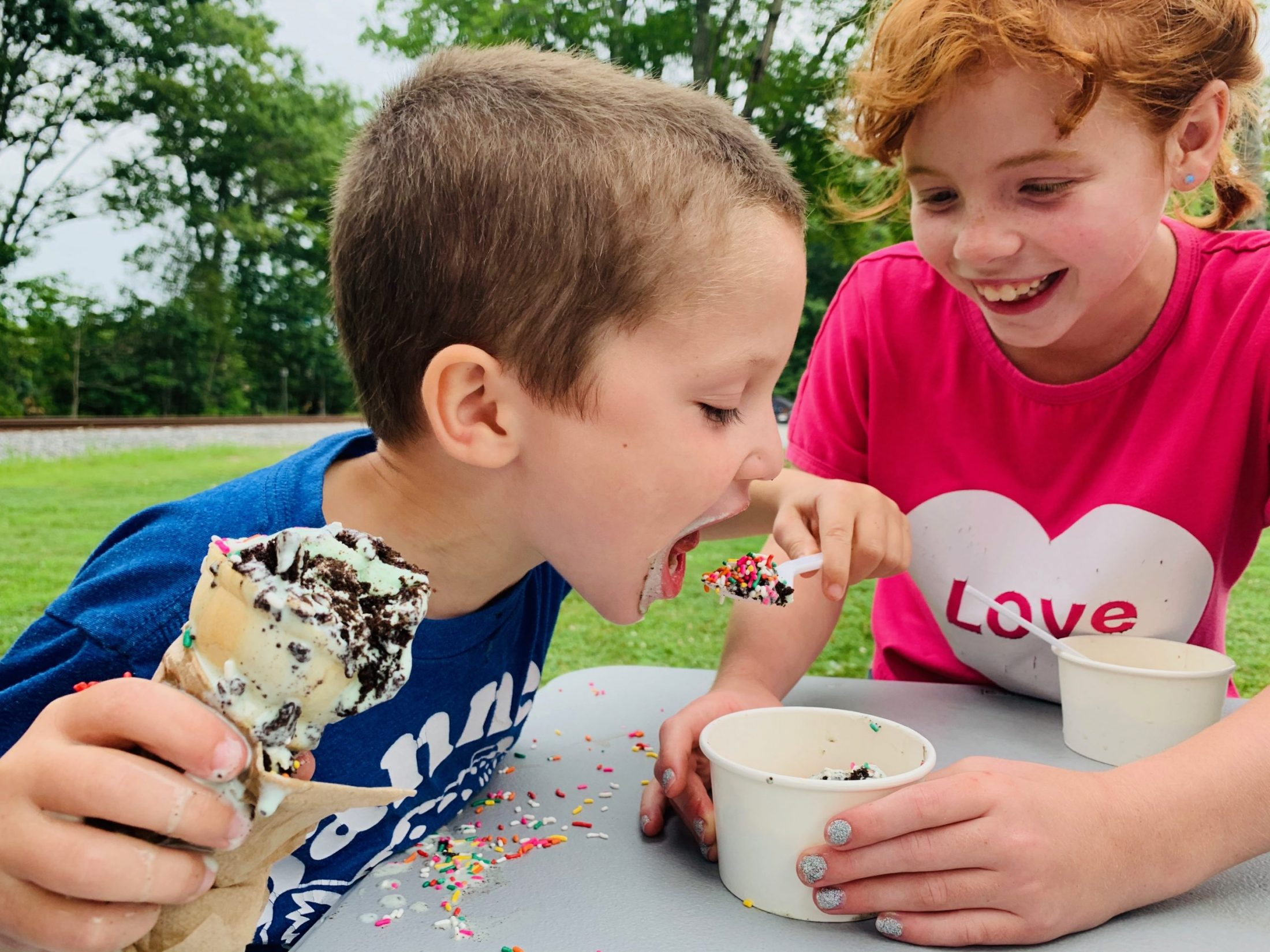 Son of DC widow blog writer Marjorie Brimley eats ice cream with a friend