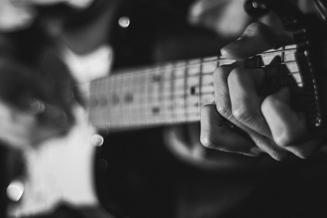 guitar and hands for blog by DC widow writer Marjorie Brimley